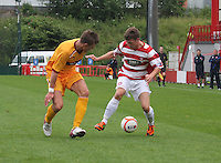 Shaun Hutchinson keeps an eye on James Martin in the Hamilton Academical v Motherwell friendly match played at New Douglas Park, Hamilton on 24.7.12..