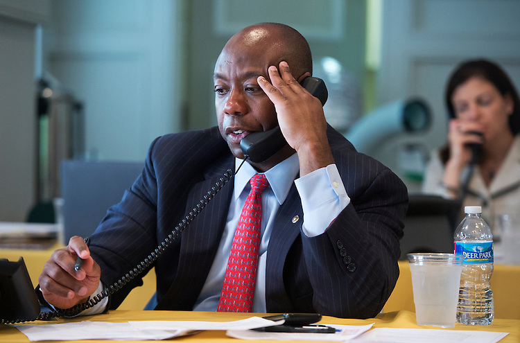 UNITED STATES - JULY 18: Sens. Tim Scott, R-S.C., and Kelly Ayotte, R-N.H., make calls to donors during a fund drive at the National Republican Senatorial Committee. (Photo By Tom Williams/CQ Roll Call)
