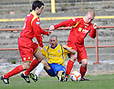 COWDENBEATH'S LIAM CUSACK IS TAKEN OUT BY ALBION'S SIMON MARRIOT (6) AND BARRY RUSSELL (3)