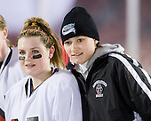 Annie Hogan (NU - 3), Nicole Stock (NU - Assistant Coach) - The Northeastern University Huskies practice on the ice at Fenway Park on Thursday, January 7, 2010, in Boston, Massachusetts.