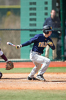 Matt Hansen (5) of the Toledo Rockets follows through on his swing against the Virginia Tech Hokies at The Ripken Experience on February 28, 2015 in Myrtle Beach, South Carolina.  The Hokies defeated the Rockets 1-0 in 10 innings.  (Brian Westerholt/Four Seam Images)