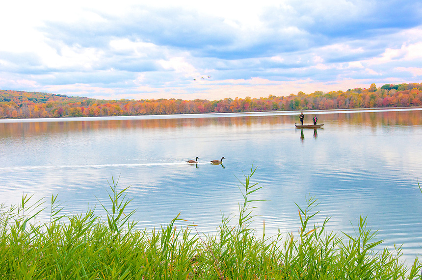 Fishing on a Rockland Lake on a warm Autumn day.