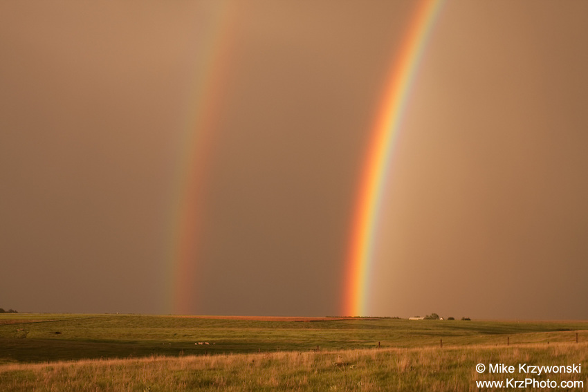 Double rainbow over a golden field in Oakley, KS