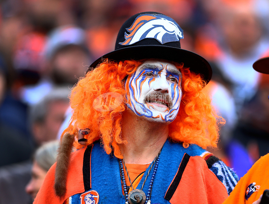 Jan 24, 2016; Denver, CO, USA; A Denver Broncos fan in the crowd wears face paint against the New England Patriots in the AFC Championship football game at Sports Authority Field at Mile High. The Broncos defeated the Patriots 20-18 to advance to the Super Bowl. Mandatory Credit: Mark J. Rebilas-USA TODAY Sports