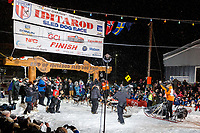 Pete Kaiser crosses the Nome finish line winning the 2019 Iditarod Trail Sled Dog Race. Pete's winning time is 9 days 12 hours 39 minutes and 6 seconds<br /> <br /> Photo by Jeff Schultz/  (C) 2019  ALL RIGHTS RESERVED