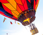 A near record crowd hot air balloon fans filled the hillsides at the National Balloon Classic launch field July 29 for opening ceremonies, balloon launches and music. A balloonist sends a blast of heat and fire into his balloon for a quicker rise skyward.