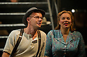 "London, UK. 16/09/2011. ""Street Scene"" by Kurt Weill (music) and Elmer Rice (book) returns to The Young Vic, London. 24 hours in the life of a 1940's New York City tenement on a hot summer's day with an eighty-strong cast, full choir and orchestra. James McOran-Campbell (as Mr Easter) and Simone Sauphanor (as Mrs Fiorentino). Photo credit: Jane Hobson"