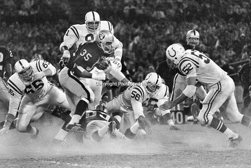 Raider Hewritt Dixon is surrounded by a host of Colts.<br />(1970 photo /Ron Riesterer)