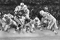 Raider Hewritt Dixon is surrounded by a host of Colts.<br />