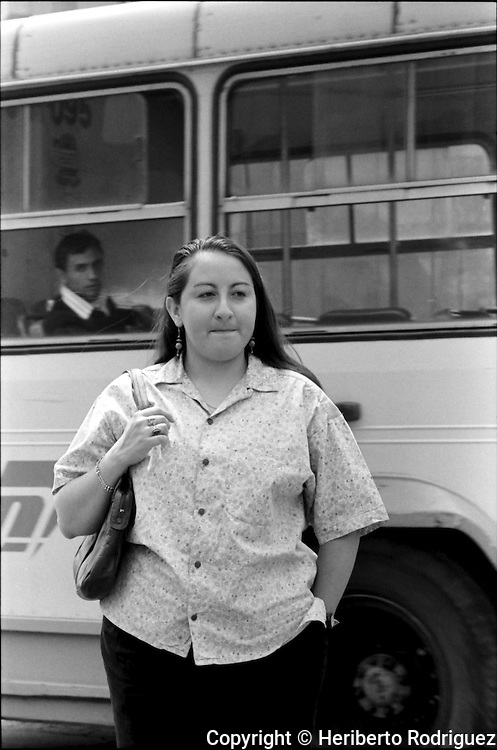 Mexican poet Raquel Huerta-Nava in a Mexico City's main thoroughfare, April 28, 1993 .  © Photo by Heriberto Rodriguez