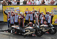Mar. 12, 2012; Gainesville, FL, USA; NHRA pro stock motorcycle rider Eddie Krawiec celebrates with teammate Andrew Hines and crew after winning the Gatornationals at Auto Plus Raceway at Gainesville. The race is being completed on Monday after rain on Sunday. Mandatory Credit: Mark J. Rebilas-