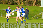 Gripping: Kerins O'Rahillys' Giles O'Grady keeps an armlock on.Laune Rangers' Liam Hassett in their County League Division 1.game in Killorglin.