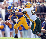 BROOKINGS, SD - SEPTEMBER 28:  Austin Sumner #6 from South Dakota State University is brought down by Brian Scheatz #61 from North Dakota State University in the first quarter of their game Saturday afternoon at Coughlin Alumni Stadium in Brookings. (Photo by Dave Eggen/Inertia)