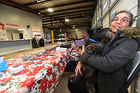 NWA Democrat-Gazette/FLIP PUTTHOFF<br /> MUZZLE NUZZLE<br /> Pam Brown gets a nuzzle from her dog, Soy Sauce, on Saturday Jan. 6 2017 while tending her table of soaps and related items at the winter Rogers Farmers Market at First and Cherry streets in downtown Rogers. The market is open each Saturday from 10 a.m. to 2 p.m. through April. Summer hours of 8 a.m.to 1 p.m. on Saturdays resume in May, said Mary Christine Neal, market manager. This is the inaugural season for the winter market, she said.