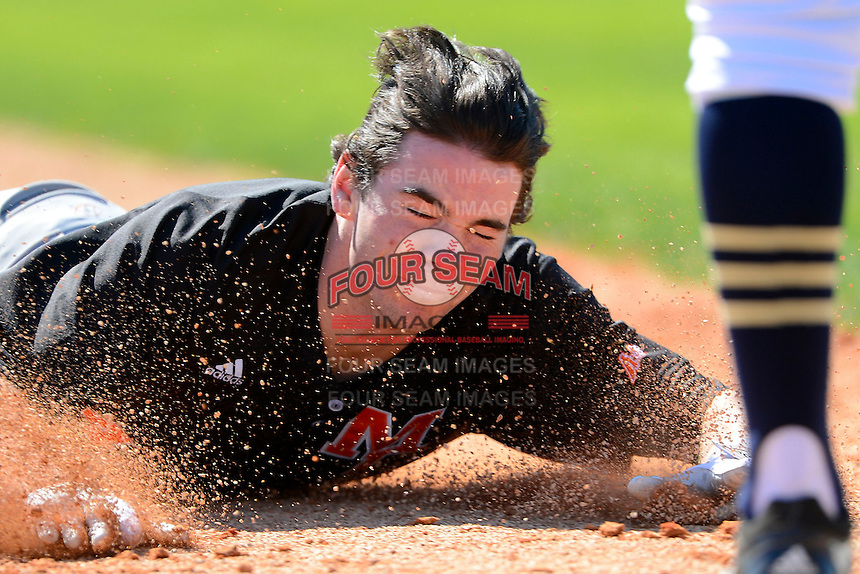 Mercer Bears infielder Chesny Young #4 slides head first into third base during a game against the Notre Dame Fighting Irish at the Buck O'Neil Complex on February 17, 2013 in Sarasota, Florida.  Mercer defeated Notre Dame 5-4.  (Mike Janes/Four Seam Images)