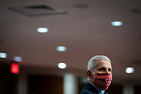 Anthony Fauci, director of the National Institute of Allergy and Infectious Diseases, wears a face covering as he listens during a Senate Health, Education, Labor and Pensions Committee hearing in Washington, D.C., U.S., on Tuesday, June 30, 2020. Top federal health officials are expected to discuss efforts to get back to work and school during the coronavirus pandemic. <br /> Credit: Al Drago / Pool via CNP /MediaPunch