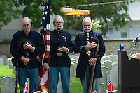 Union soldier re-enactors stand at attention during ceremonies at the Camp Chase Cemetery in Columbus, Ohio, Sunday, June 4, 2006. The Hilltop community association adopted maintenance of the Civil War cemetery and offers an annual memorial service honoring the more than 2,200 soldiers for the Confederacy and other Southern sympathizers buried in the small plot of land on the city's southeast side.<br />