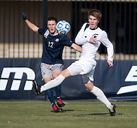 Keegan Rosenberry (12) of Georgetown crosses the ball past Dewey Lewis (14) of Michigan State during the third round of the NCAA tournament at Shaw Field in Washington, DC. Michigan State defeated Georgetown, 1-0.