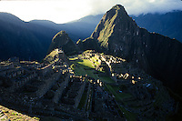 Patches of sunlight break through the clouds over the Inca citadel of Machu Picchu in central Peru.