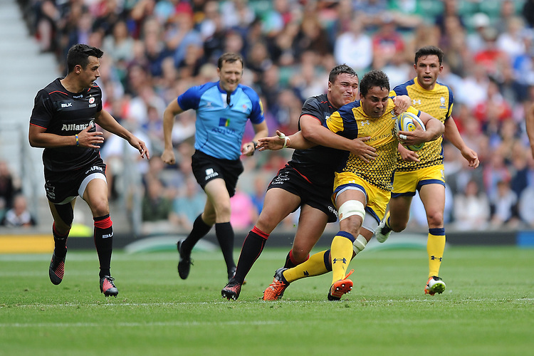 Marco Mama of Worcester Warriors is brought down by Jamie George of Saracens during the Aviva Premiership Rugby match between Saracens and Worcester Warriors at Twickenham Stadium on Saturday 03 September 2016 (Photo by Rob Munro/Stewart Communications)