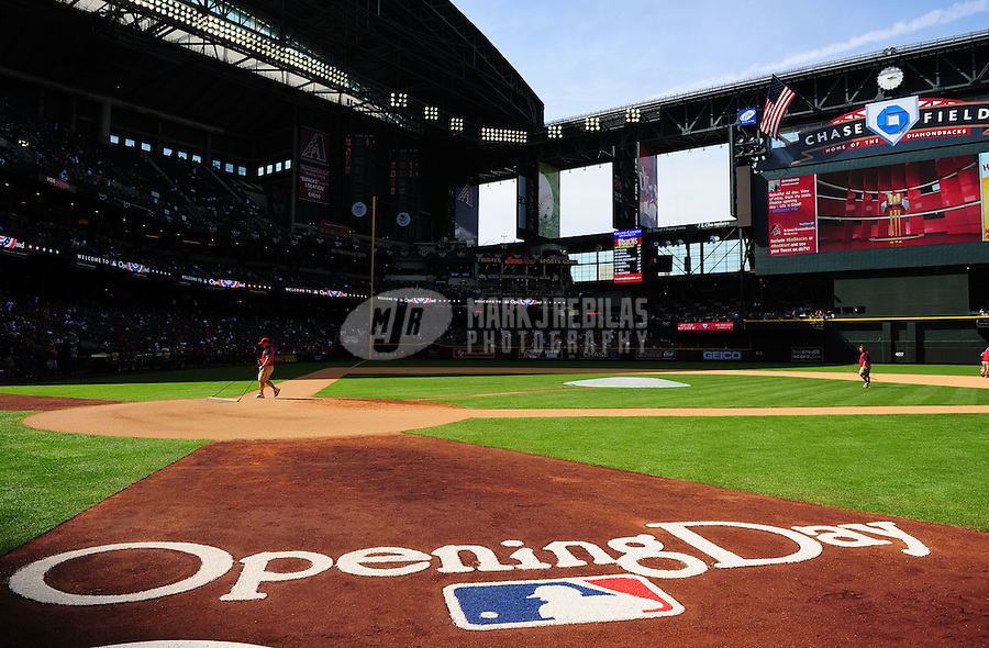 Apr. 6, 2012; Phoenix, AZ, USA; Arizona Diamondbacks groundskeepers prepare the field prior to the game against the San Francisco Giants during opening day at Chase Field.  Mandatory Credit: Mark J. Rebilas-