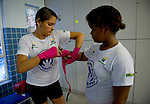 "LAUREUS WORLD SPORTS AWARDS 2013, RIO DE JANEIRO, BRAZIL..VISIT TO LUTA PELA PAZ, ""FIGHT FOR PEACE"" IN THE COMPLEXO DA MARE, A FAVELA DIVIDED BY DRUG GANGS..THE PROJECT, FOUNDED IN 2000 BY LUKE DOWDNEY, A BRITISH AMATEUR BOXER, PROVIDES TRAINING AND EDUCATION..GIRLS TAPING THEIR HANDS FOR BOXING..9-3-2013 PIC BY IAN MCILGORM"