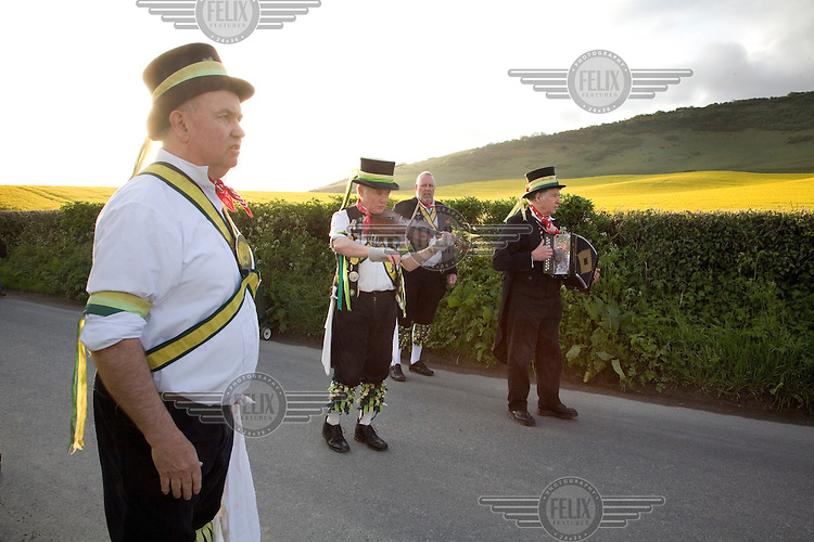 Members of The Longman Morris 'side' dance on mayday. Morris dancing.