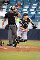 Jupiter Hammerheads J.T. Realmuto #9 looks for a ball in front of umpire Shane Livensparger during a Florida State League game against the Tampa Yankees at Legends Field on July 17, 2012 in Tampa, Florida.  Tampa defeated Jupiter 12-0.  (Mike Janes/Four Seam Images)