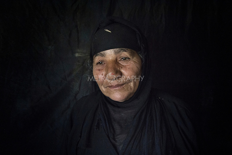 23/06/2015 -- Dibaga-Makhmur-, Iraq -- Hindia Salah from Jarallah village, inside her new home at the chicken farm in Dibaga.<br /> Her son who was detained by the Assaish when he wanted join the Shia militia Hashd shabie. Her grand child Retaj 2 Y.O. lives with her now for his father was killed in Mosul last year.