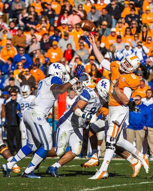 Tennesse junior quarterback Tyler Bray gets the ball off while under pressure from Kentucky's defense in Knoxville, Tn., on Saturday, November, 24, 2012. Photo by James Holt | Staff
