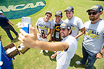 MUSCLE SHOALS, AL - MAY 25: The Lynn University team takes a selfie with the championship trophy during the Division II Men's Team Match Play Golf Championship held at the Robert Trent Jones Golf Trail at the Shoals, Fighting Joe Course on May 25, 2018 in Muscle Shoals, Alabama. Lynn defeated West Florida 3-2 to win the national title. (Photo by Cliff Williams/NCAA Photos via Getty Images)