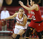 VERMILLION, SD - MARCH 27, 2016 -- Tia Hemiller #4 of South Dakota drives against Kendall Noble #12 of Western Kentucky during their WNIT game Sunday evening at the Dakotadome in Vermillion, S.D.  (Photo by Dick Carlson/Inertia)