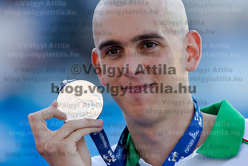 Laszlo Cseh (HUN) celebrates during the award ceremony after placing second the 200 m Men's Individual Medley Swimming competition during the 13th FINA Swimming World Championships held in Rome, Italy. Thursday, 30. July 2009. ATTILA VOLGYI