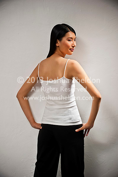 Rear view of young Asian woman standing
