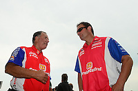 Jul. 1, 2012; Joliet, IL, USA: NHRA funny car driver Johnny Gray (left) with his son pro stock driver Shane Gray during the Route 66 Nationals at Route 66 Raceway. Mandatory Credit: Mark J. Rebilas-