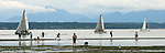 Seattle, Puget Sound, Seattleites walk the tide flats on a spring low tide, Golden Gardens Park, Ballard, Washington State, Pacific Northwest, USA,
