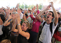 Fans cheer as Bruce Springsteen finishes a song during a free concert held Tuesday afternoon at the nTelos Wireless Pavilion in Charlottesville, Va.