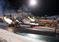Sep 2, 2016; Clermont, IN, USA; NHRA top fuel driver Wayne Newby (near) races alongside Luigi Novelli during qualifying for the US Nationals at Lucas Oil Raceway. Mandatory Credit: Mark J. Rebilas-USA TODAY Sports