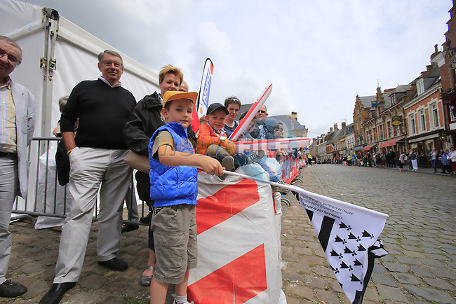 Young fans wait for the race to pass through the ancient town of Cassel during Stage 4 of the 2014 Tour de France running 163.5km from Le Touquet to Lille. 8th July 2014.<br /> Picture: Eoin Clarke www.newsfile.ie