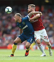 West Ham United's Marko Arnautovic and Arsenal's Shkodran Mustafi<br /> <br /> Photographer Rob Newell/CameraSport<br /> <br /> The Premier League - Arsenal v West Ham United - Saturday August 25th 2018 - The Emirates - London<br /> <br /> World Copyright © 2018 CameraSport. All rights reserved. 43 Linden Ave. Countesthorpe. Leicester. England. LE8 5PG - Tel: +44 (0) 116 277 4147 - admin@camerasport.com - www.camerasport.com