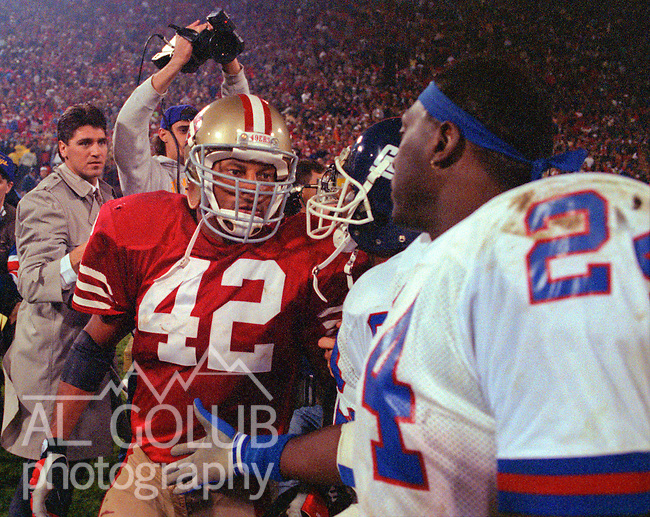 San Francisco 49ers vs New York Giants at Candlestick Park Monday, December 3, 1990..49ers beat Giants 7-3.49er defensive back Ronnie Lott (42) and Giants running back Ottis Anderson (24) after game...