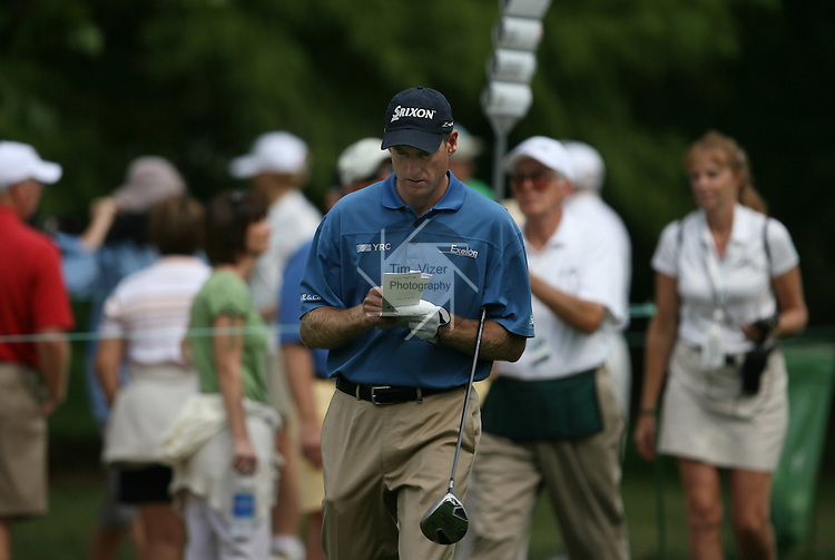 6 September 2008:   Jim Furyk checks his notes in-between holes in the third round of play at the BMW Golf Championship at Bellerive Country Club in Town & Country, Missouri, a suburb of St. Louis, Missouri. Furyk was the leader after the conclusion of round two with a score of 62.  After the first nine holes of the 18-hole third round, Furyk was 11 under-par.  The BMW Championship is the third event of the Fed Ex Cup and the top 30 finishers will qualify for the next event of the championship.