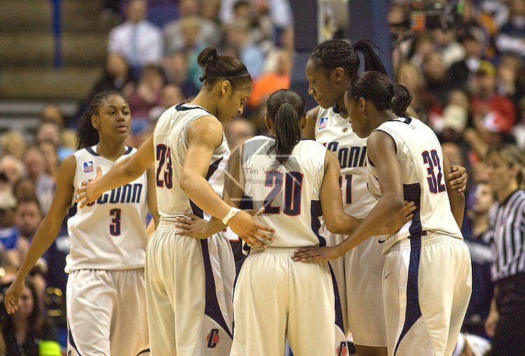040709TVWOMENSFINALFOUR25.UConn players (left to right) Tiffany Hayes (3), Maya Moore (23), Renee Montgomery (20), Tina Charles (31), and Kalana Greene (32) huddle late in their game against Louisville.  The Huskies defeated the Louisville Cardinals, 76-54, to win the NCAA Women's Final Four National Championship at the Scottrade Center in St. Louis, MO on Tuesday April 7, 2009..MCT/TIM VIZER