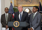 United States President Donald J. Trump makes remarks prior to signing a proclamation to honor Dr. Martin Luther King, Jr. Day in the Roosevelt Room of the White House in Washington, DC on Friday, January 12, 2018.  Looking on from left is US Secretary of Housing and Urban Development Ben Carson and looking on from right is Isaac Newton Farris, Jr., Nephew of Martin Luther King Jr.<br /> Credit: Ron Sachs / CNP
