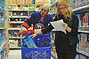 "Casey Cizikas of the New York Islanders and wife Kristy Cizikas fill their cart with presents at Toys ""R"" Us in Carle Place during the team's holiday shopping for children in hospitals on Thursday, Nov. 30, 2017. The gifts will be hand-delivered to children in eight local hospitals by the players on Monday, Dec. 18."