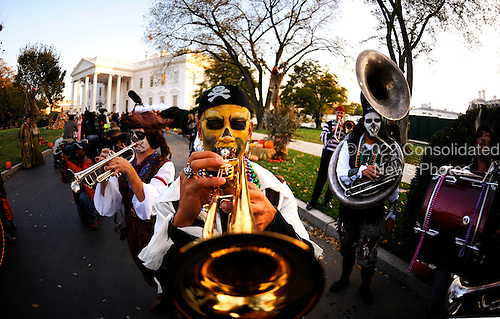 A band is performing for Halloween as people gather at the North Portico of the White House in Washington on Friday, October 31, 2010. United States President Barack Obama and First Lady Michelle Obama will  greet trick or treaters at the North Portico of the White House as they celebrate Halloween..Credit: Olivier Douliery / Pool via CNP