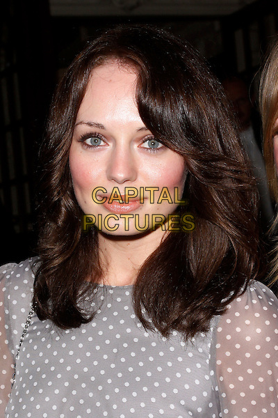 Laura Haddock.'Top Hat' press night, Aldwych Theatre, London, England..May 9th, 2012.headshot portrait grey gray white polka dot sheer top.CAP/AH.©Adam Houghton/Capital Pictures.