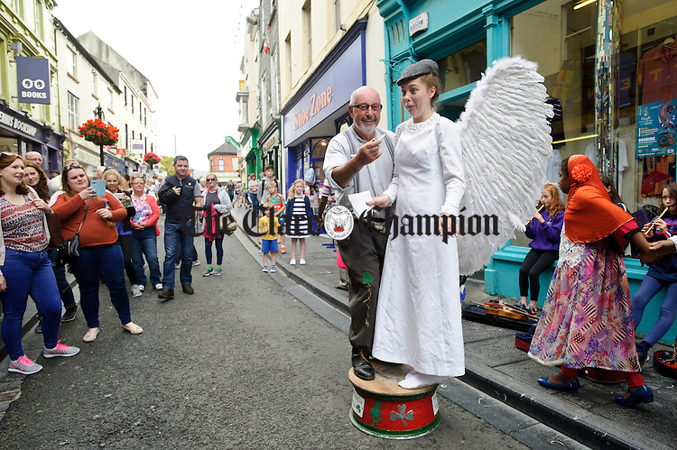"Heavens Above....Street performer Kevin Cuniffe of Ballinasloe is joined by ""Angel"" Neidin Mooney of Ennis for a performance during Fleadh Cheoil na hEireann in Ennis. Photograph by John Kelly."