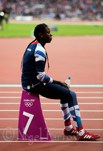 04 AUG 2012 - LONDON, GBR - Christine Ohuruogu (GBR) of Great Britain prepares for the start of the first women's 400m semi final at the London 2012 Olympic Games athletics at the Olympic Stadium in the Olympic Park, Stratford, London, Great Britain .(PHOTO (C) 2012 NIGEL FARROW)