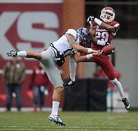 NWA Media/ J.T. Wampler - Arkansas' Jared Collins breaks up a pass intended for Ole Miss' Evan Engram during the first quarter Satyurday Nov. 22, 2014.